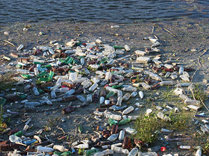Plastic Trash Floating River Water Pollution © Emilian Robert Vicol