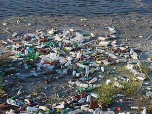 Plastic Trash Floating River Water Pollution © Emilian Robert Vicol